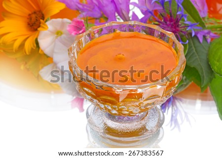 Natural flower honey with pollen in a glass vase - stock photo