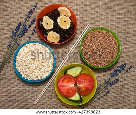 Natural food. Rice and vegetables with flowers - stock photo