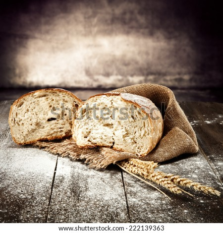 natural fresh bread and flour on desk  - stock photo