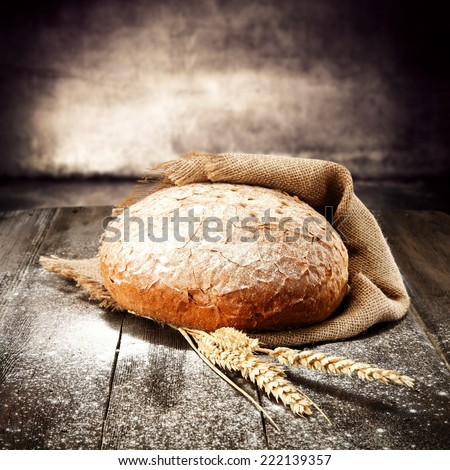 natural fresh bread and table of flour  - stock photo