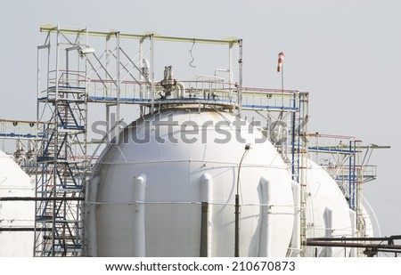 Natural gas processing installation with storage facilities at an oil and gas refinery - stock photo