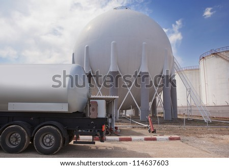 Natural Gas Tank and filling up to truck - stock photo