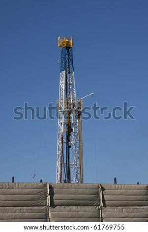 natural gas well drilling in open field - stock photo