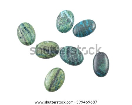 Natural gemstone chrysocolla beads in a white background. - stock photo