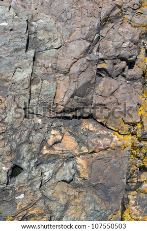 Natural granite rock texture worn by the sea. - stock photo