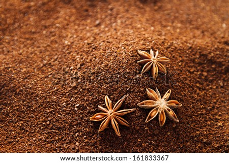 Natural ground coffee background with star anise and some spilled sugar - stock photo