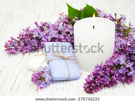 Natural handmade soap and lilac flowers on a wooden background - stock photo