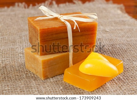 natural handmade soap, tied with twine on fabric - stock photo