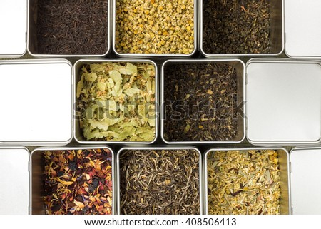 Natural herbal fruit tea in metal jars, tasty english tradition, family collection: mint, chamomile,dried fruits, linden, 5 o'clock, closeup food photography - stock photo
