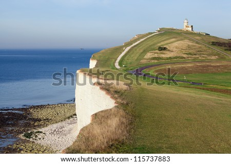 Natural landscape : lighthouse overlooking white cliffs . Beachy Head, Eastbourne, East Sussex, UK - stock photo