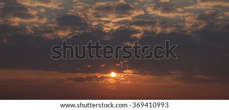 Natural light and dark morning clouds - stock photo