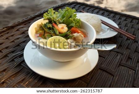 Natural light photo of lemongrass seafood soup with steamed rice, shallow DOF view 3 - stock photo