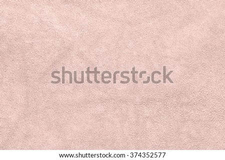 Natural light pink suede texture as background. - stock photo
