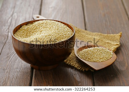 Natural organic cereal quinoa on a wooden table - stock photo