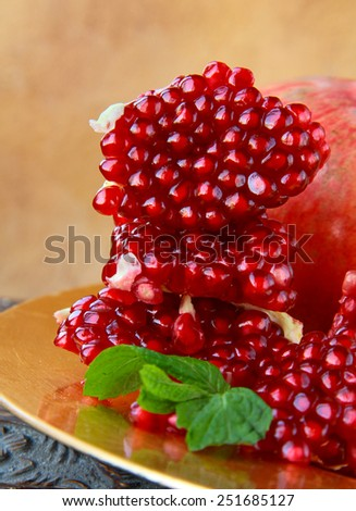 natural organic juicy ripe pomegranate on the table - stock photo