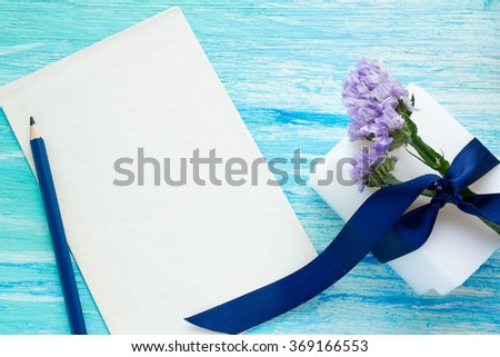 natural organic loofah soap with flowers on a blue wooden table Spa, birthday, women's day, mockup, text, note, notebook, texture - stock photo
