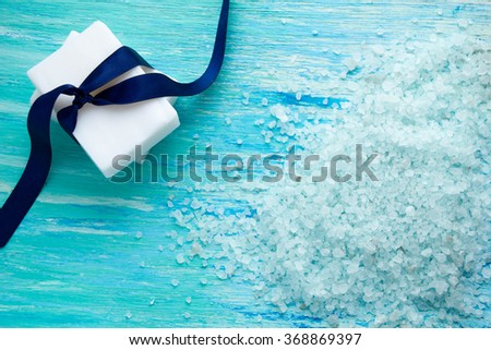 natural organic soap, and sea salt  on a blue wooden table - stock photo