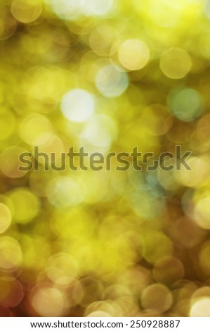 Natural outdoors bokeh  in golden autumn tones - stock photo