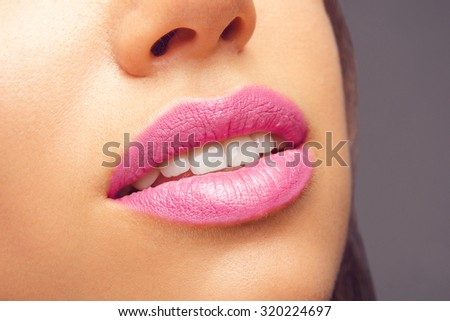 Natural Perfect Lips. Beauty young woman Smile. Natural plump full Lip. Lips augmentation. Sexy Girl Mouth Close Up. Fashion Make-up, Style and Cosmetics - stock photo
