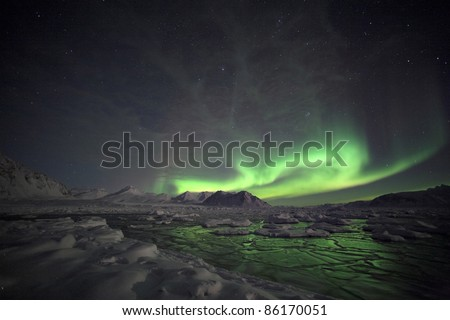 Natural phenomenon of Northern Lights (Aurora Borealis) related to the earth's magnetic field, ionosphere and solar activity - stock photo