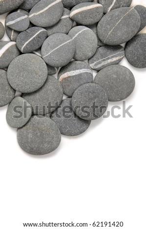 Natural piles of pebbles with copy space - stock photo