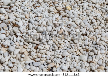 natural polished white river rock pebbles background - stock photo