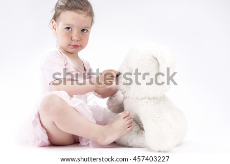 Natural Portrait of Cute Blond Caucasian Child With Positive Facial Expression. Holding Big Teddy Bear Plush Toy.Horizontal Image - stock photo