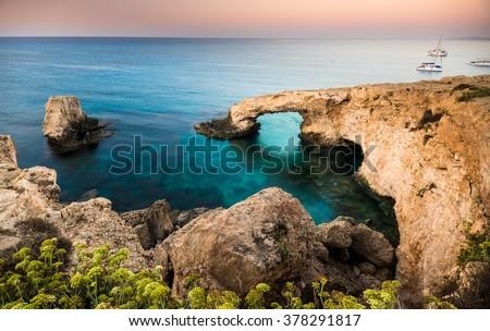Natural rock arch of Ayia Napa on Cyprus (long exposure shot) - stock photo