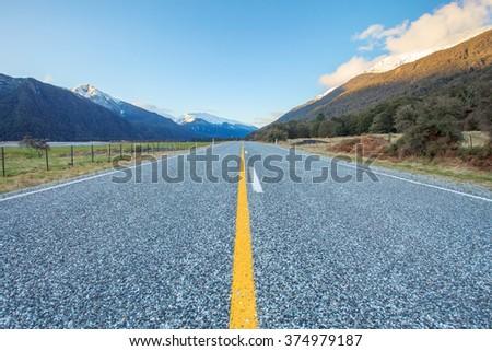 natural scenic asphalt highway in aspiring national park south island new zealand - stock photo