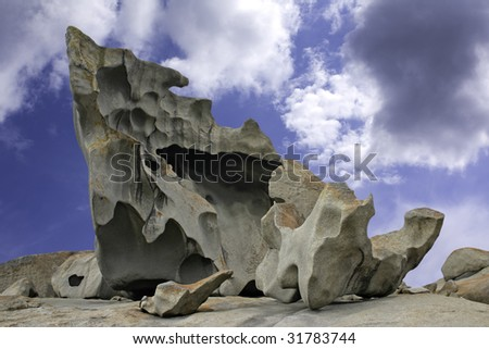 Natural sculpture against blue sky and clouds at the Remarkable Rocks outcrop in Flinders Chase National Park on Kangaroo Island, South Australia - stock photo