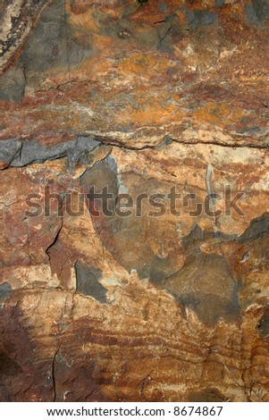 Natural slate in shades of brown,grey, red and yellow. - stock photo