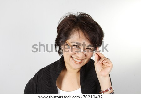 Natural smily woman, Asian Woman with natural smily face wearing glasses. - stock photo