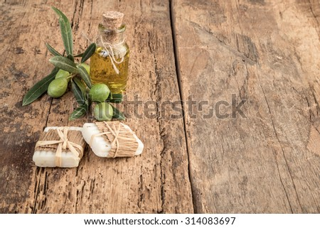natural soap bars made by olive and oil on wooden table - stock photo