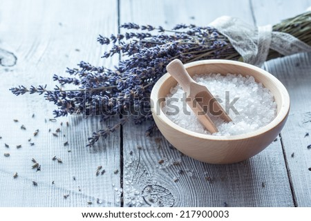 Natural soap, lavender, salt on a wooden board, hygiene items for bath and spa.  - stock photo