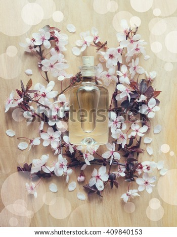Natural spa product concept, spa essential oil or lotion in glass bottle, top view, stylized photo - stock photo