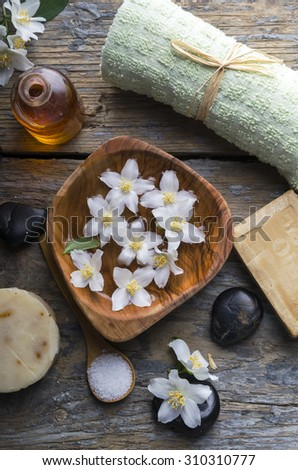 Natural spa product on rustic wood - stock photo