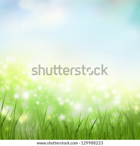 Natural spring and summer background with selective focus and grass on foreground - stock photo