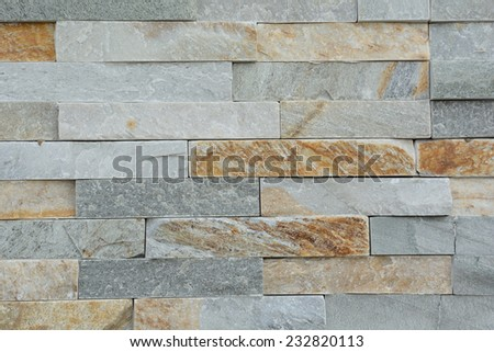 Natural stones of a stone wall - stock photo