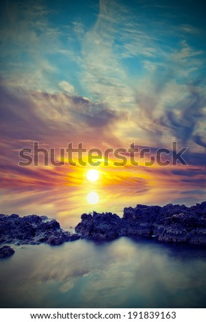 Natural sunset with reflection in the sea. Vintage style - stock photo