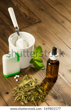 Natural sweetener stevia in various forms like dried liquid powder and dissolvable tablets - stock photo