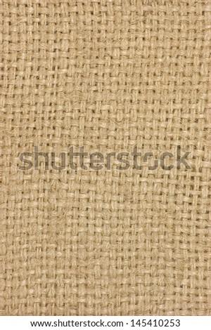 Natural textured burlap sackcloth hessian texture coffee sack, light country sacking canvas, vertical macro closeup background pattern - stock photo