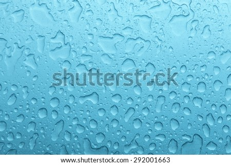 natural water drop from the rain on glass - stock photo