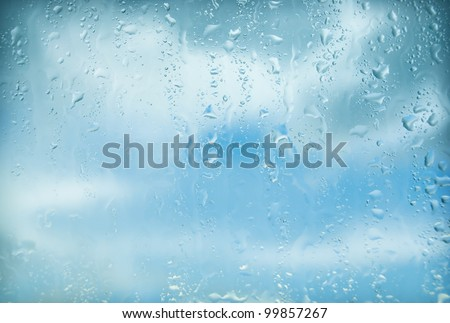 natural water drops on window glass - stock photo
