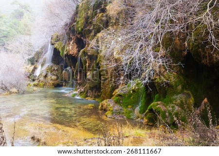 Natural   waterfall at river  in winter. Cuenca, Spain - stock photo
