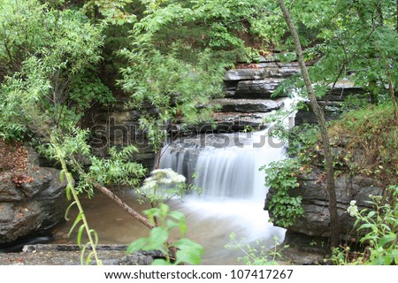 Natural waterfall flowing through an Ozark forest in Northwest Arkansas. - stock photo