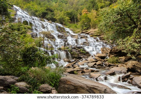 Natural waterfall in tropical forest - stock photo