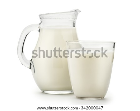 Natural whole milk in a jug and a glass isolated on a white background closeup - stock photo