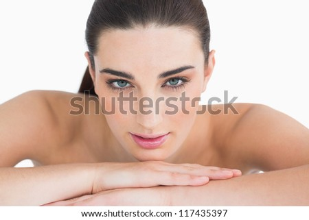 Natural woman leaning on her arms on white background - stock photo