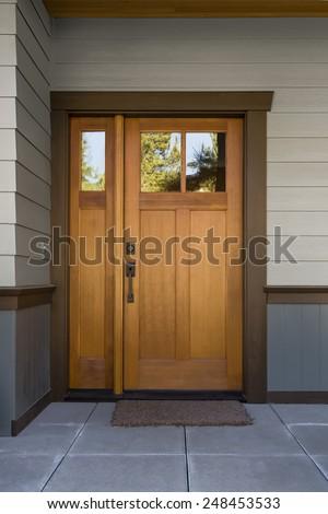 Natural Wood Door at Tiled Entryway  - stock photo