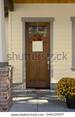 Natural Wood Front Door with Window and Entryway in Foreground - stock photo